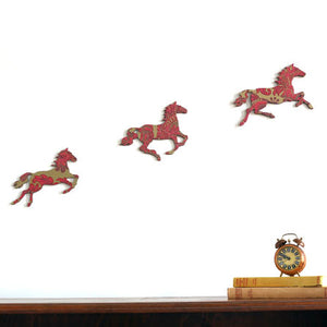 Burgundy and Gold Galloping Horses