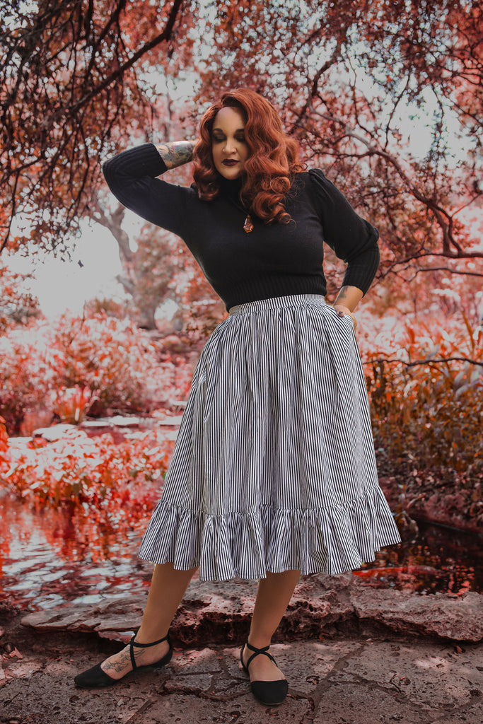 modeling wearing vintage inspired gothic skirt with black and white stripes