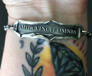 Silver Latin quote bracelet, handmade sterling 'love conquers all' cha in bracelet. 'amor vincit omnia'.
