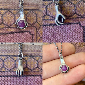 Sterling, tiny hand sculpture hold raw natural ruby crystal. handmade pendant, sterling silver
