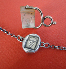 Load image into Gallery viewer, Bracelet with Antique Wax seal Amulet,    Erin Go Bragh,   various sizes, sterling silver.