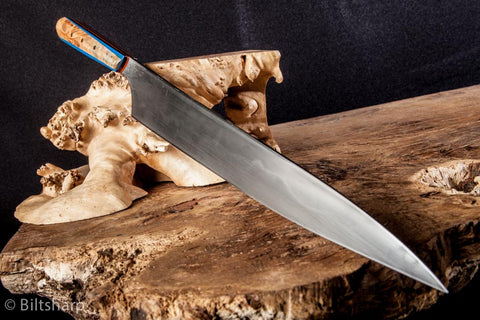 Burl Yangi Clay tempered 1095, full tang 100mm blade, right handed asymmetrical traditional Japanese grind. Dyed maple burl handle with padauk, blue and orange G10 liners.