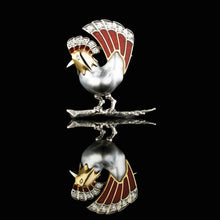 A BUNDA Cultured Tahitian Keshi pearl and enamel rooster brooch in 18-carat yellow gold and platinum, set with round brilliant cut diamonds and a grey baroque shaped Tahitian Keshi pearl of clean skin and excellent lustre with silver tones.  Characteristics of diamonds: 11 = 0.28ct, F-G/VS  Total weight: 10.59g