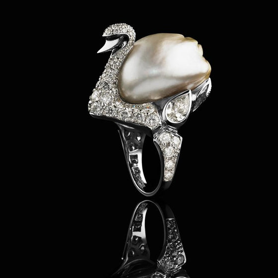 A BUNDA 'Swan' ring in platinum, featuring an exquisite, baroque Cultured South Sea Keshi Pearl, champagne in colour with a clean skin and an excellent lustre. The Swan itself features a round brilliant cut diamond pave set body with bezel set pear and marquise diamonds.  Dimensions of pearl: 15.80-21.80mm  Characteristics of pear shaped diamonds: 2 = 1.13ct, D-F colour, SI1 clarity.  Characteristics of marquise diamonds: 2 = 0.49ct, F colour, VS clarity.  Characteristics of round brilliant cut diamonds: 90