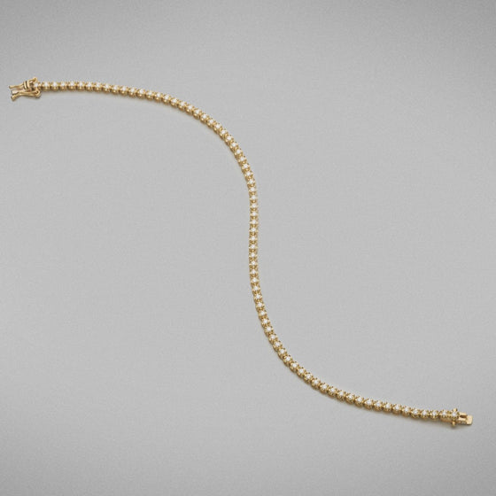 A BUNDA diamond 'Tennis' bracelet in 18ct yellow gold. The bracelet is set with round brilliant diamonds in crown settings.  Characteristics of Round Brilliant Cut Diamonds: 72 = 1.08ct, F colour, VS Clarity  Total weight: 5.89 grams