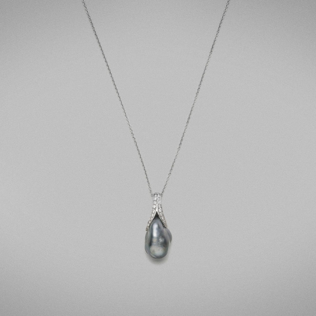 'Caelum' Cultured Tahitian Keshi pearl and Diamond Pendant in 18 carat white gold, featuring a baroque shaped Keshi pearl, set with a diamond thread-set cap that follows the curve of the pearl and is fitted with an 18 carat white gold trace chain.  Total diamond weight = 0.23ct, F Colour; VS Clarity