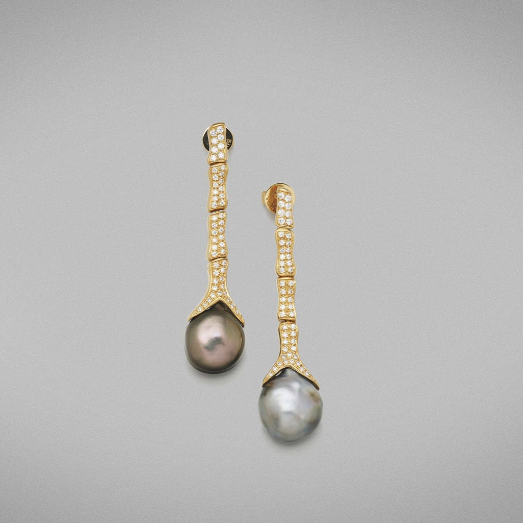 Each earring is set with a baroque shaped keshi pearl with clear skin and excellent lustre. Every 'Caelum' link is pave set with round brilliant diamonds and is articulated. Earrings are fitted with posts and butterflies.  Total diamond weight = 0.61ct.  Total weight of earrings = 15.92 grams