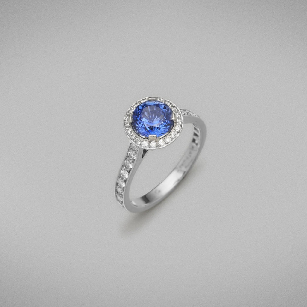 "A BUNDA ""Sitara"" ring four claw set with a round blue Sapphire and surrounded by threadset fine brilliant cut diamonds, and with threadset fine brilliant cut diamond shoulders, mounted in all platinum.  Sapphire weighs: 1.79cts  The characteristics of the diamonds are: 40 = 0.46 ct., F colour, VS clar  Ring weighs: 4.48 grams"