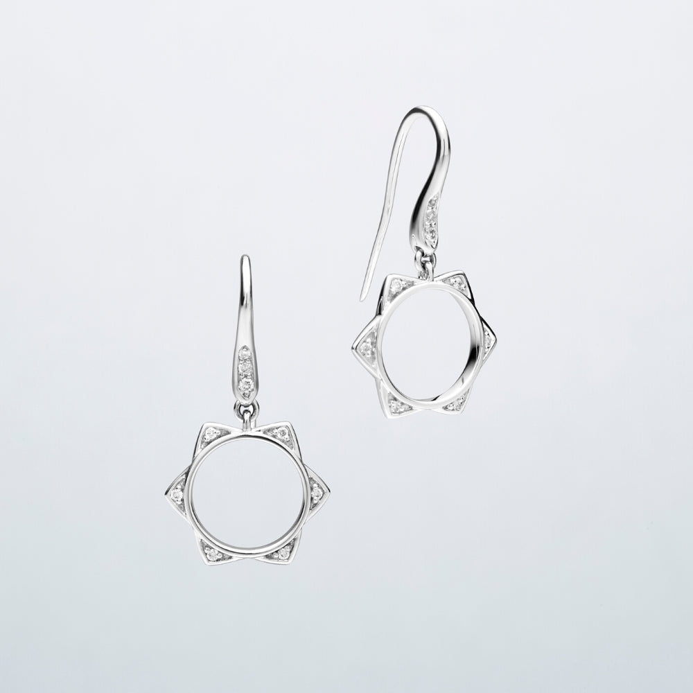 'BUNDA Star' Diamond Earrings in 18ct white gold. A pair of BUNDA Star diamond earrings in 18 carat white gold, featuring bead set, round brilliant cut diamonds on each point of the star, fitted with a thread-set diamond hook.