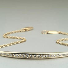 A BUNDA 'Line' bracelet in 18ct yellow gold. The 'Line' setting is thread-set with round brilliant diamonds and is suspended with a fine 18ct yellow gold trace chain which closes with an 18ct yellow gold parrot clasp.  Characteristics of diamonds: 31 = 0.21cts; F Colour / VS Clarity  Bracelet has tag stamped 'BUNDA' Total weight = 3.89grams
