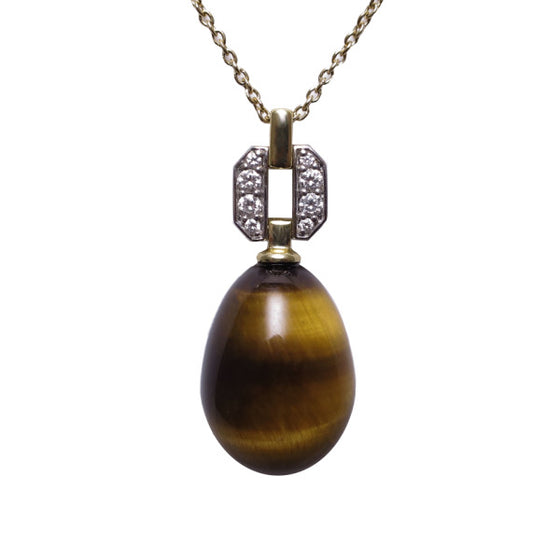 A BUNDA 'Hollywood' pendant in 18ct white and 18ct yellow gold featuring a Tigers Eye drop fitted below a threadset, round brilliant cut diamond pendant mount with an 18ct yellow gold trace chain. The tigers eye drop weighs approximately 11.50ct.  Characteristics of diamonds: 8 = 0.09ct, F colour, VS clarity.