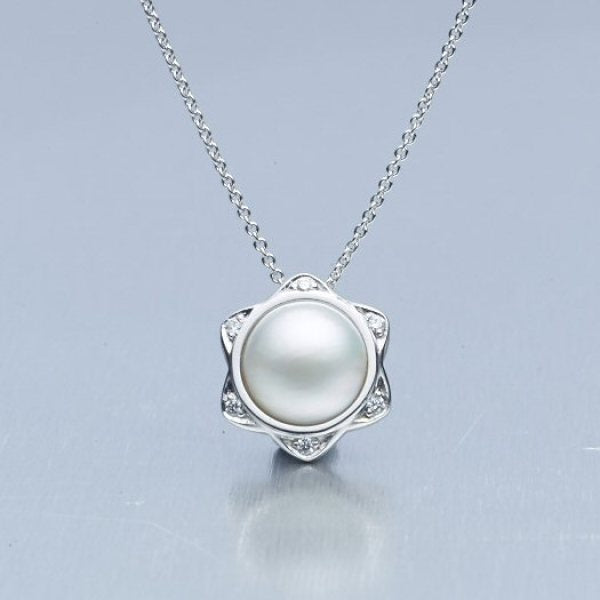 'Star' Cultured Mabe Pearl and Diamond pendant