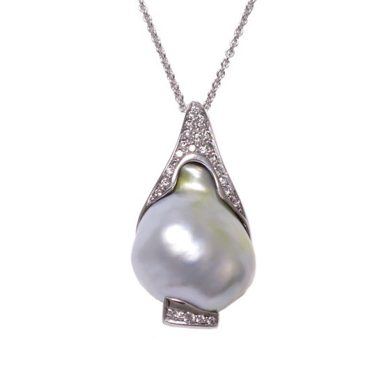 A BUNDA 'Caelum' Cultured South Sea Keshi pearl and Diamond Pendant in 18 carat white gold, featuring a baroque shaped Keshi pearl, set with a diamond threadset cap that follows the curve of the pearl and is fitted with an 18 carat white gold trace chain.  The Keshi pearl measures approximately 15.19 - 17.33mm, is white with silver colouring, and has a clean skin and an excellent lustre.  Characteristics of diamonds: 28 = 0.21ct, F colour, VS clarity.