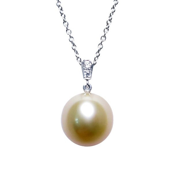 A BUNDA Cultured South Sea pearl and diamond 'Russe' pendant in 18 carat white gold, featuring a drop shaped golden pearl of clean skin and excellent lustre, on an 18 carat white gold Trace chain. Dimensions of pearl: 10.49 - 10.57mm Characteristics of diamonds: 2 = 0.03ct, F colour, VS clarity.