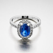 A BUNDA 'Valentin' Kyanite and diamond ring in 18 carat white gold, featuring an oval cut Kyanite, surrounded with castle set round brilliant cut diamonds to the head and shoulders.  Weight of Kyanite: 2.03ct  Characteristics of diamonds: 36 = 0.50ct, F colour, VS clarity.  Total weight of Ring: 4.48 grams.