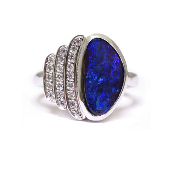 BUNDA 'Devo' opal and diamond ring in 18ct white gold, featuring an Australian Boulder Opal, and three rows of thread set round brilliant cut diamonds.  Characteristics of Opal: 1 = 2.76ct, displaying a range of green and blue colours. Origin: Queensland, Australia.  Characteristics of diamonds: 21 = 0.18ct, F colour, VS clarity.  Total weight of Ring: 9.15 grams