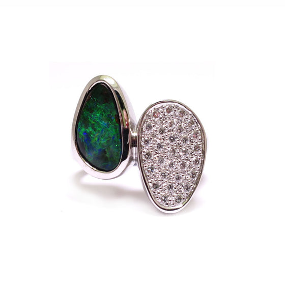 A BUNDA 'Couture' ring handcrafted in 18ct white gold, featuring a bezel set, Australian boulder opal and pave set, round brilliant cut diamonds.  Characteristics of Opal: 1 = 1.87ct. Origin: Queensland, Australia.  Characteristics of diamonds: 30 =0.31ct, F colour, VS clarity.  Total weight of Ring: 10.65g