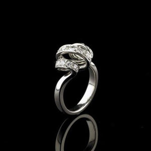 A BUNDA 'Lyra' diamond ring made in 18 carat white gold, set with round brilliant cut diamonds.  Characteristics of diamonds: 25 = 0.69ct, F colour, VS clarity.  Total Weight: 6.65g