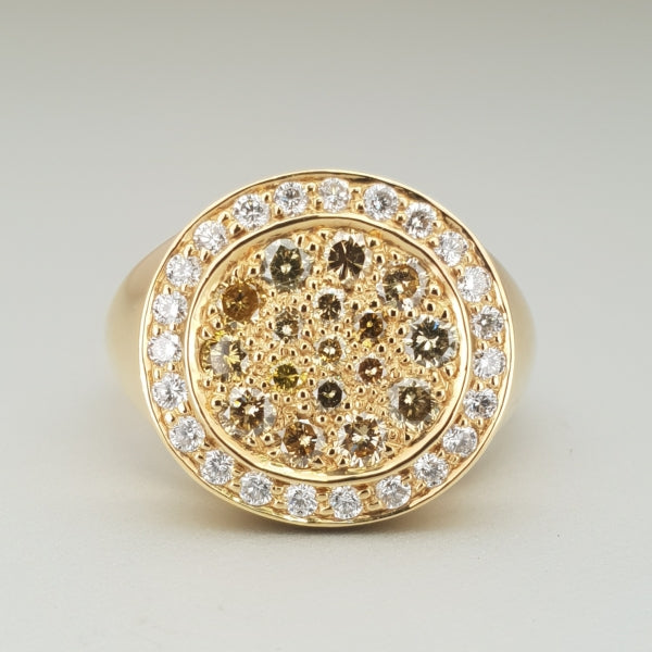 A BUNDA 'Meteor' diamond ring made in 18 carat yellow gold, set with Fancy yellow and white round brilliant diamonds. Characteristics of diamonds: 17 = 0.74ct, Fancy Yellow,Multi/ SI Characteristics of additional diamonds: 23 = 0.33ct G/SI