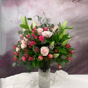 pink explosion of flowers in a tall vase by Petalino Flower Bar