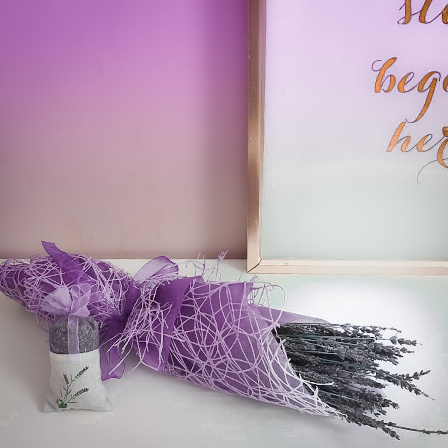 Dry lavender bunch with dry lavendar sachet wrapped in a purple paper covered in textured fabric