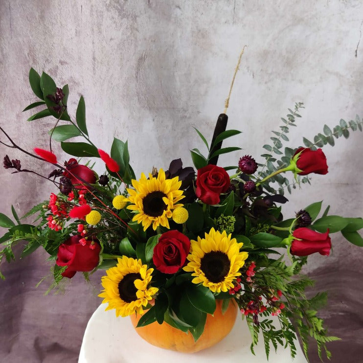 Fall flower arrangements red and yellow arranged in pumpkin | Delivery North Vancouver | Petalino Flower Bar and Events