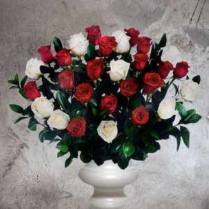 RED AND WHITE FLORAL ARRANGEMENT IN WITH URN VASE