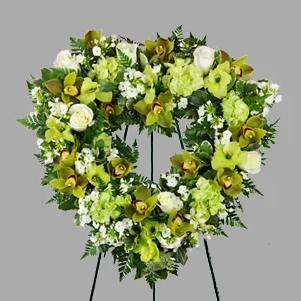 Green and white Heart wreath by Petalino Flower Bar & Events