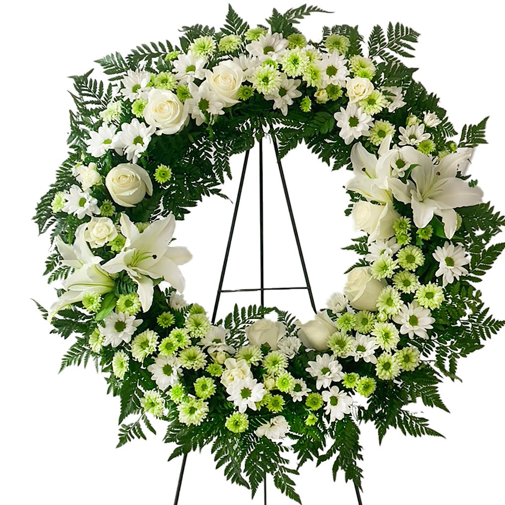 Green and white round wreath spray