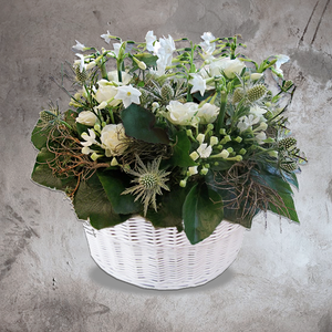 White basket of wild white and blue flowers