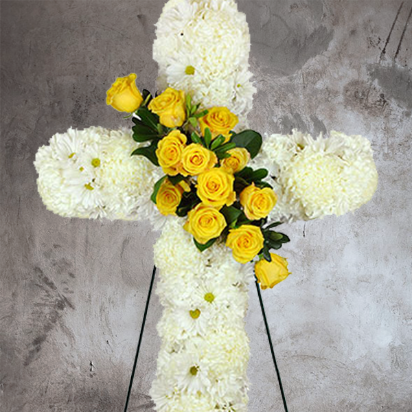 WHITE MUM COVERED CROSS SPRAY WITH ANGLED YELLOW ROSES