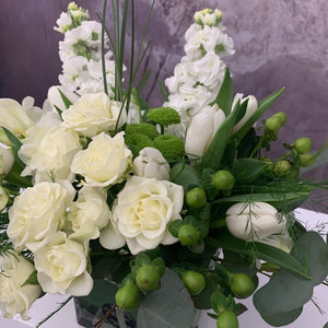 white flowers stock spray roses tulip arranged in a rectangle square glass vase- Petalino Flower Bar