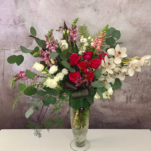 Large vase flower arangememt with hot pink roses and pink snaps, white cymbidium by Petalino Flower Bar