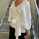 Bev - Sprinkling Kindness Wrap Blouse