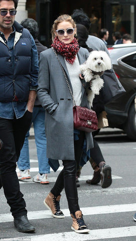 Olivia Palermo goes for understated elegance as she walks her dog