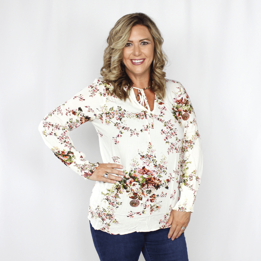 White floral long sleeve blouse with tie at neckline