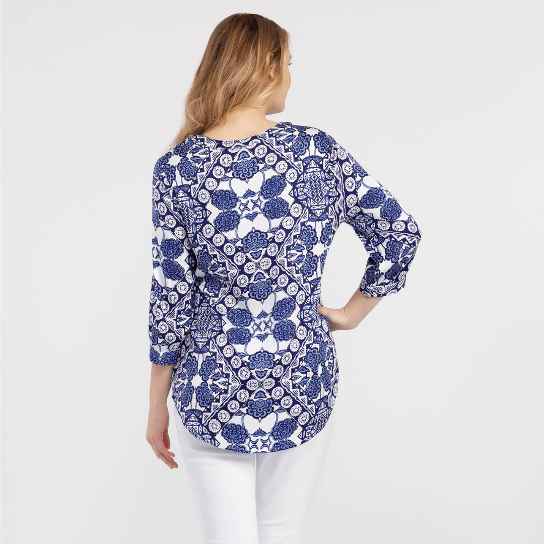 Blue and white pattered blouse, 3/4 length sleeve, tassel accent