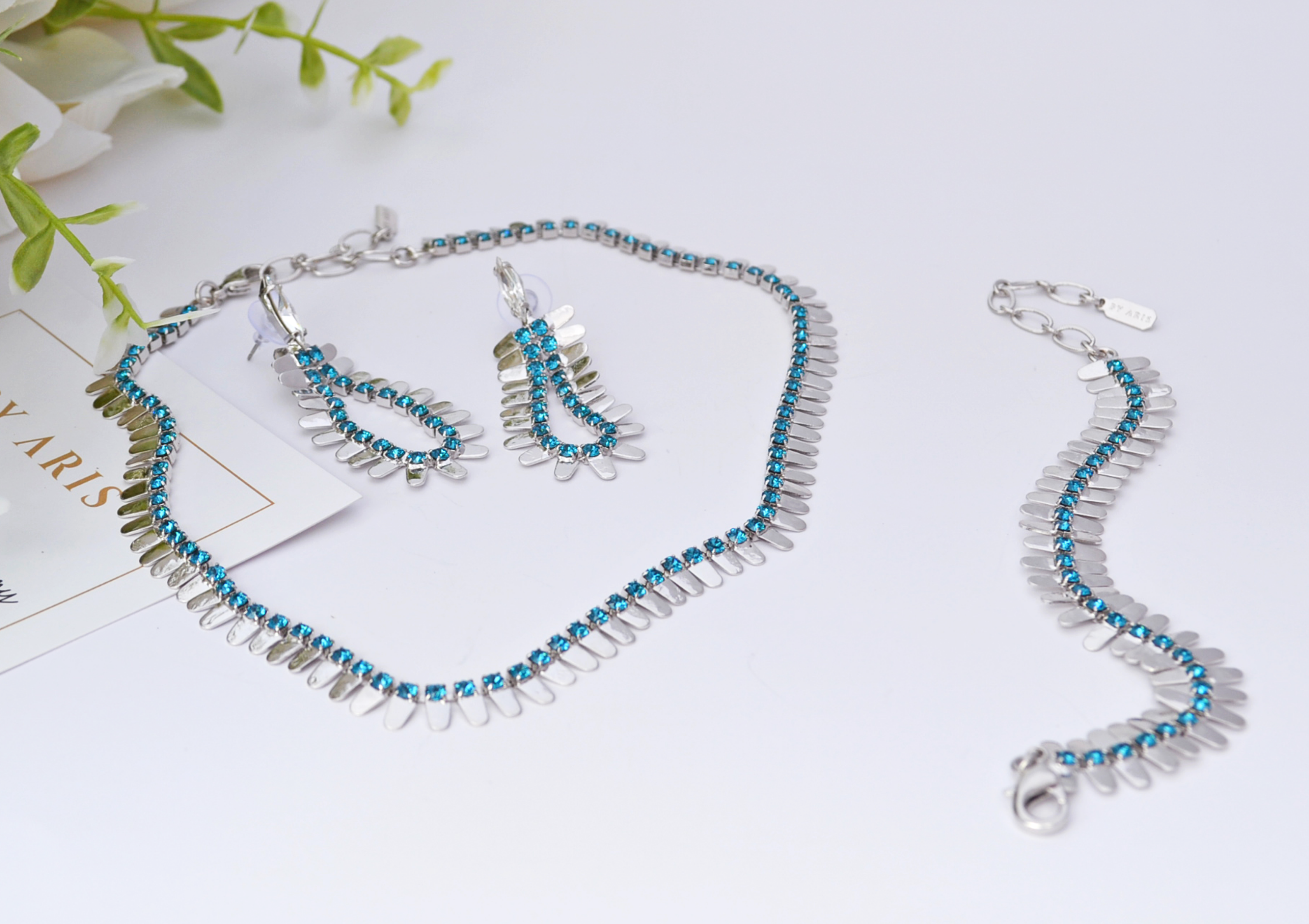 Dainty silver necklace set with blue crystals