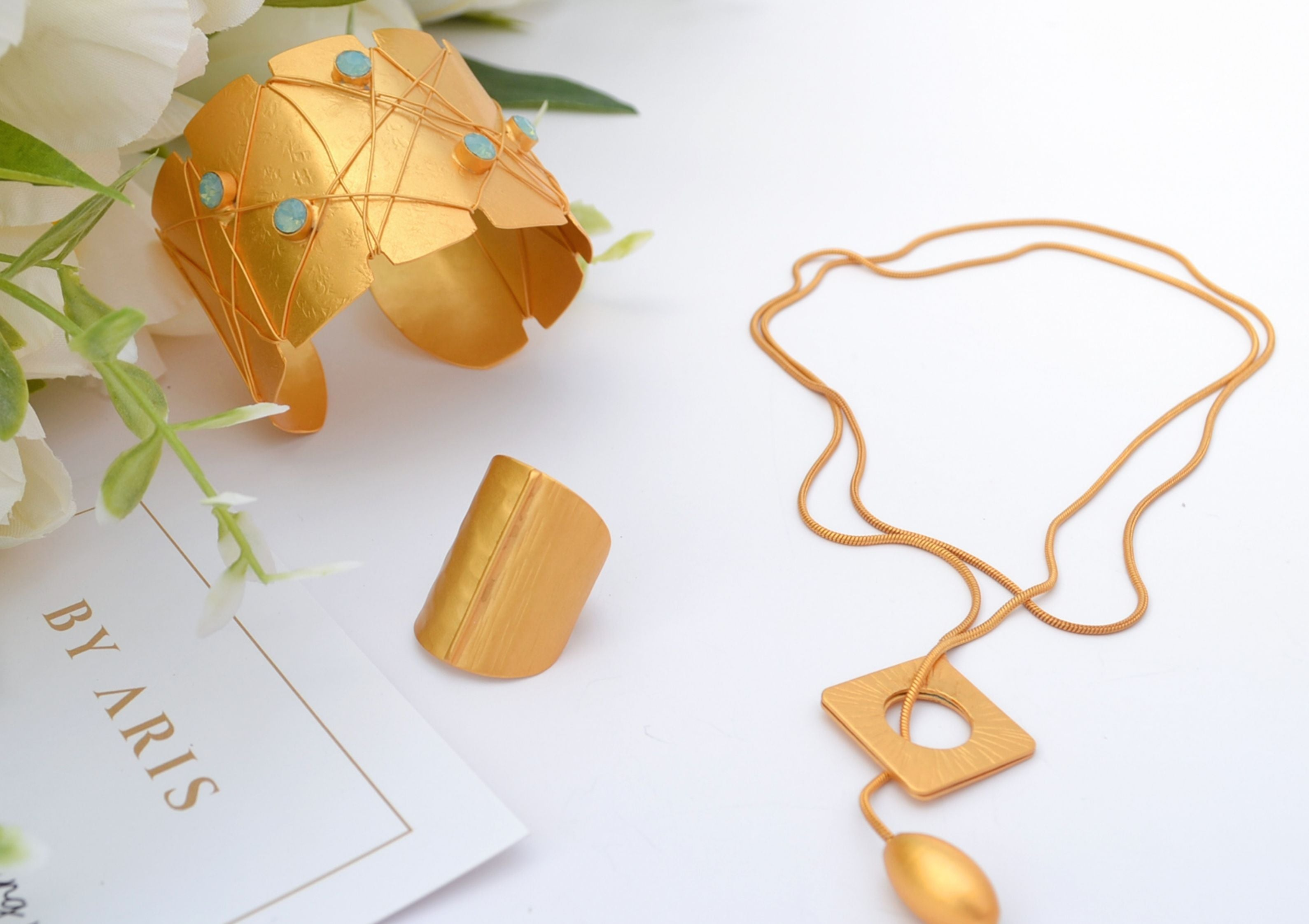 Mother's day gift suggestions, gold cuff bracelet, necklace, ring