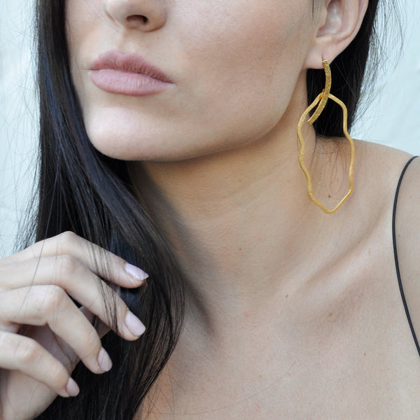 scultural hammered gold earrings