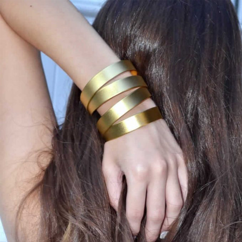 Thick gold multi band cuff bracelet