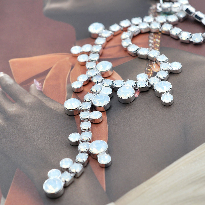 Silver Y shape costume necklace with white opal Swarovski crystals