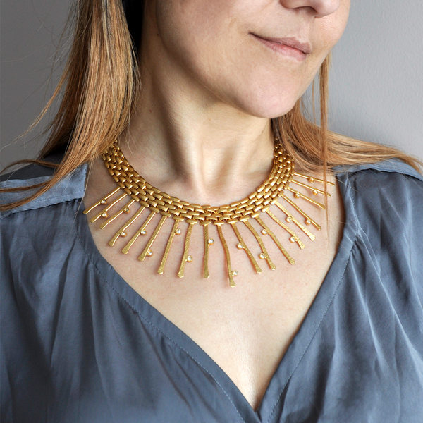 gold collar necklace with thick chain and golden crystals