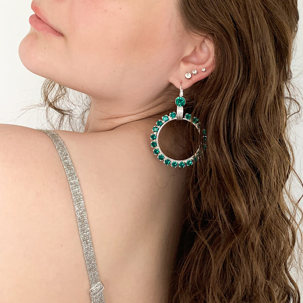silver hoop earrings with green Swarovski crystals