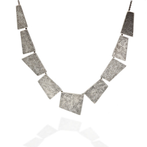 Geometrical cut silver metal statement necklace