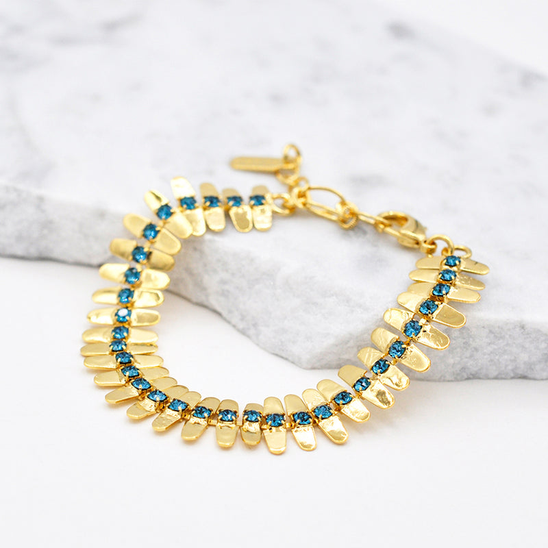 gold linked bracelet with blue swarovski