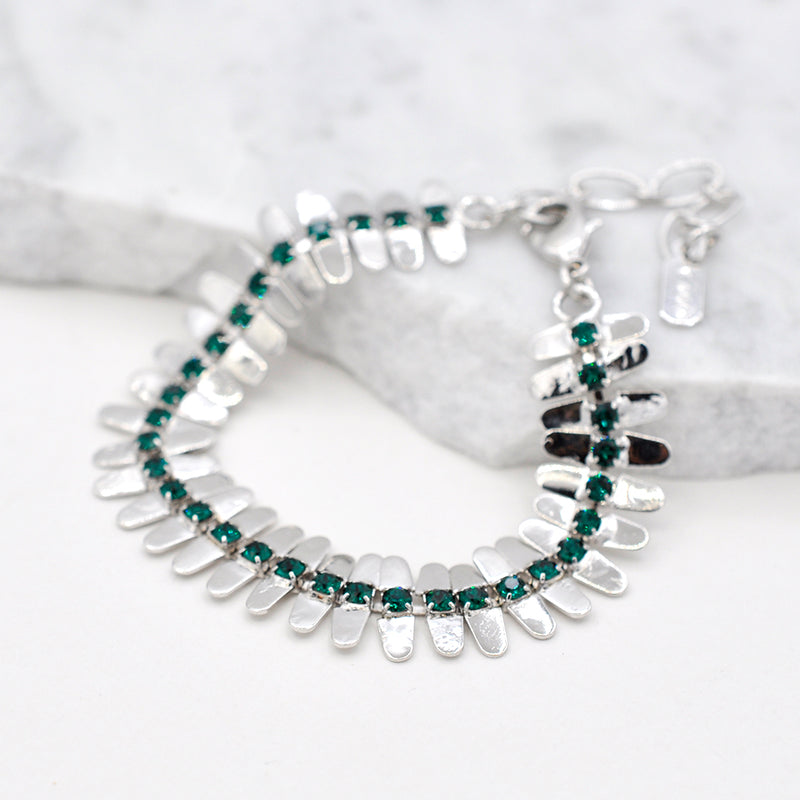 Silver linked bracelet with green swarovski