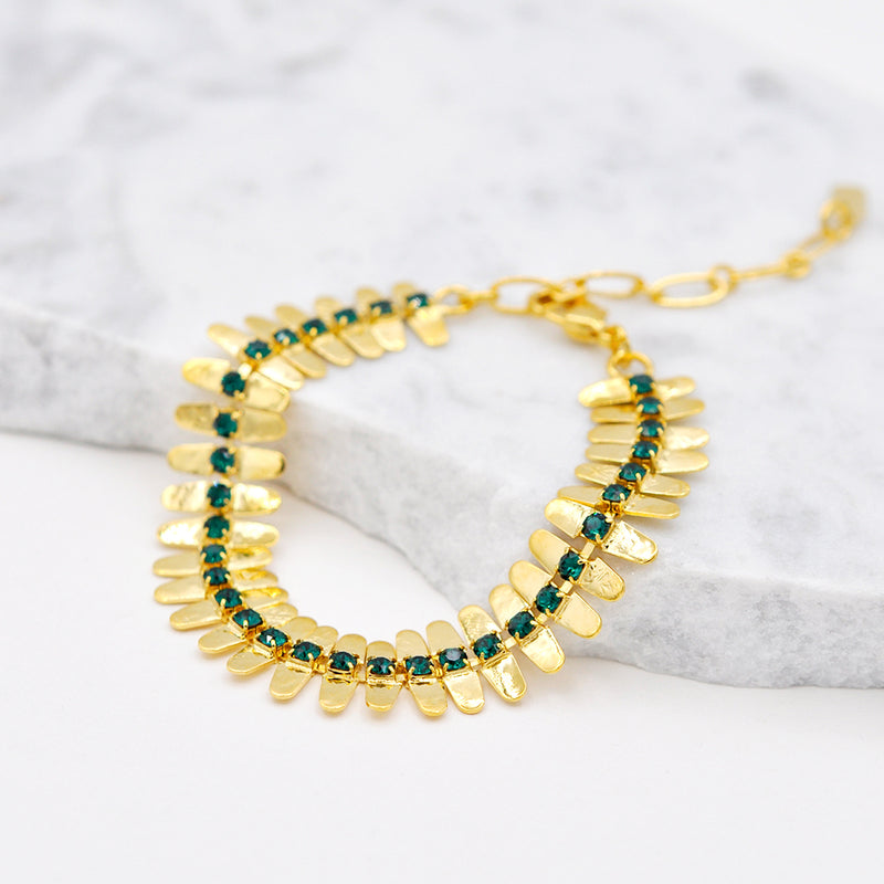 gold linked bracelet with green swarovski