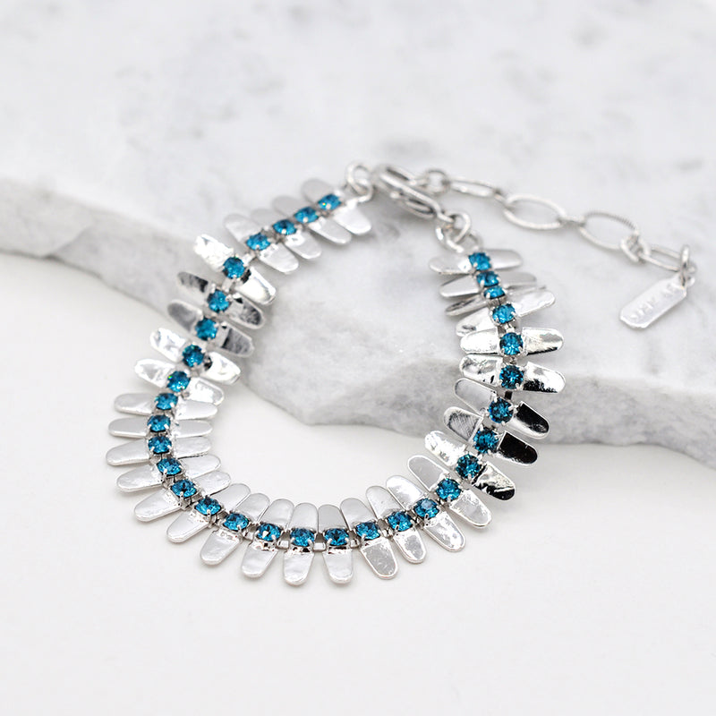 Silver linked bracelet with blue swarovski