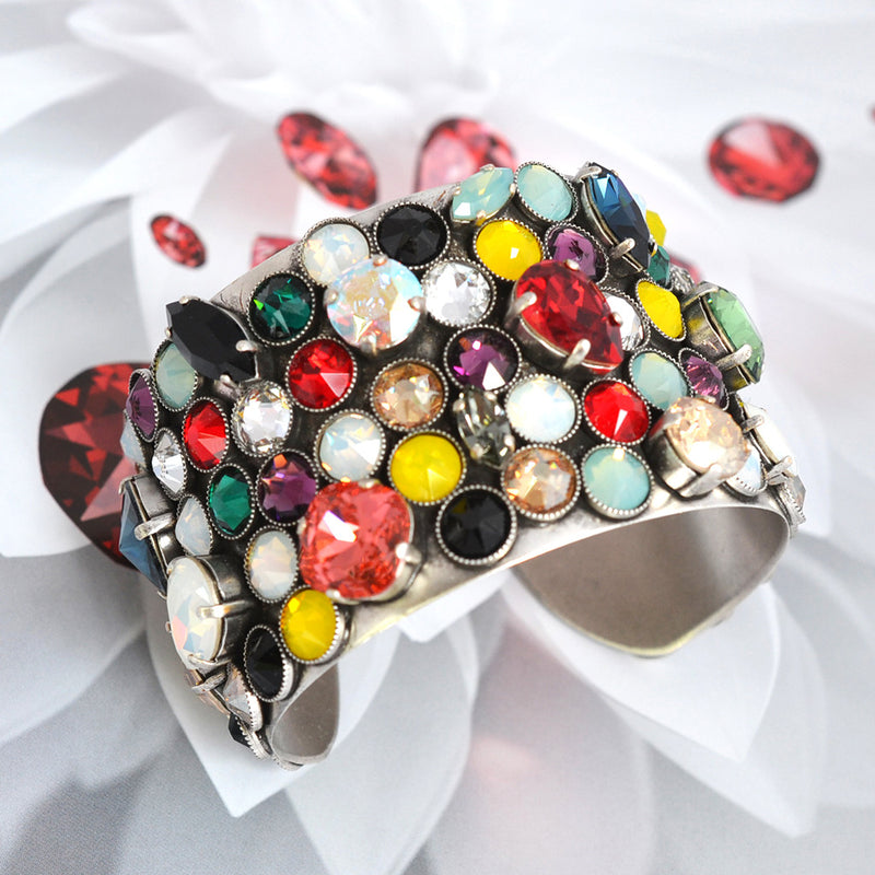 Silver cuff bracelet covered with multi color Swarovski crystal